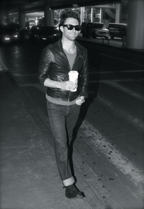 Adam Levine arrives with a cup of Java